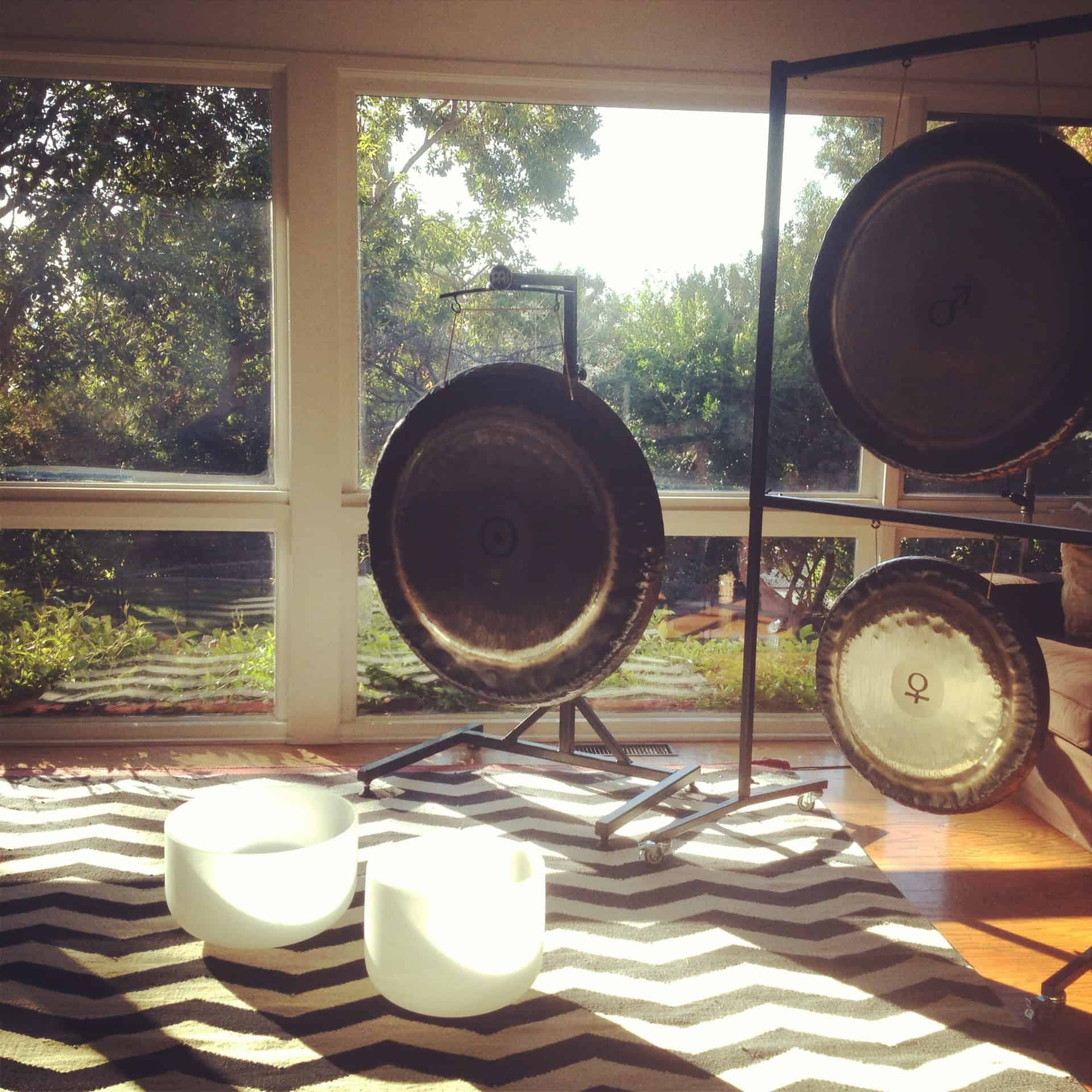 Jamie brings her own gongs and bowls. She set up in my living room.
